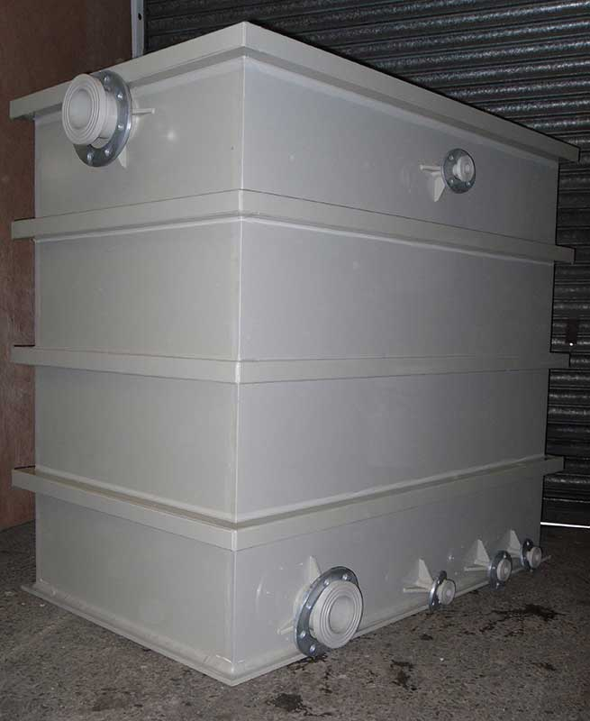 Polypropylene rectangular tank with steel reinforcement then covered over to protect the steel from chemicals